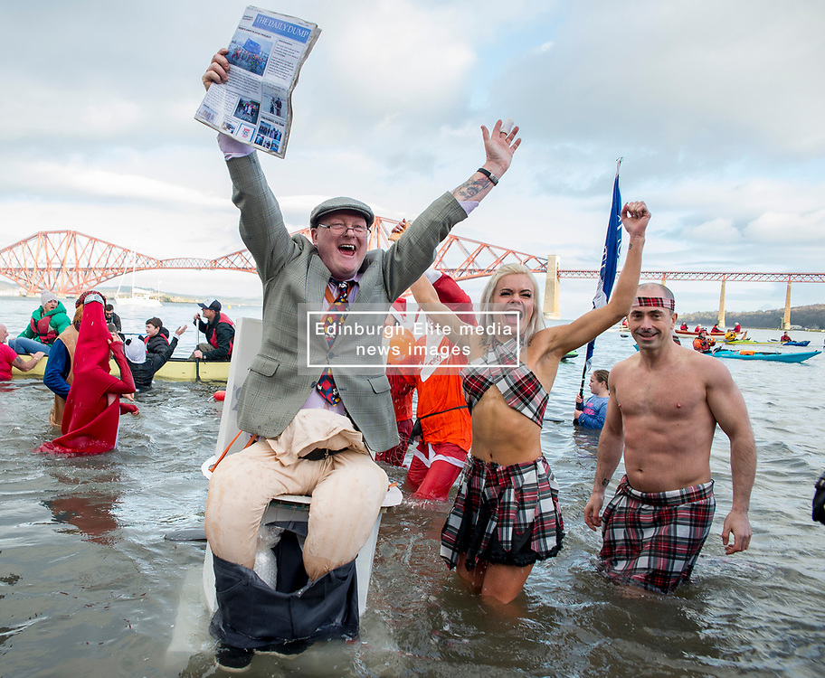 Thousands of people, many in fancy dress including Tony Pirouette from Dunfermline as 'man on the pan', took part in the annual Loony Dook New Years swim in the Firth of Forth at Queensferry in the shadow of the iconic Forth Bridges today.<br /> <br /> © Dave Johnston / EEm