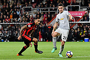Callum Wilson (13) of AFC Bournemouth looks for a way past Ander Herrera (21) of Manchester United during the Premier League match between Bournemouth and Manchester United at the Vitality Stadium, Bournemouth, England on 18 April 2018. Picture by Graham Hunt.