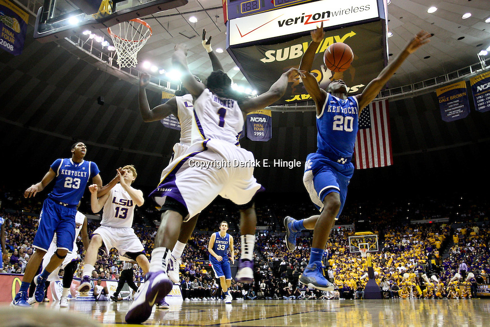 January 28, 2012; Baton Rouge, LA; Kentucky Wildcats guard Doron Lamb (20) loses the ball after being fouled by LSU Tigers forward Johnny O'Bryant (2) and guard Anthony Hickey (1) defends during the first half of a game at the Pete Maravich Assembly Center. Kentucky defeated LSU 74-50.  Mandatory Credit: Derick E. Hingle-US PRESSWIRE