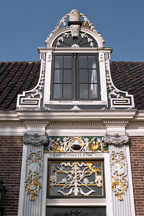 Entry detail of a historical house, 'T Koopmanshuys  (Koopman's House),  built in 1795 and preserved  at Zaanse Schans, an open-air museum that's a popular day trip from Amsterdam.