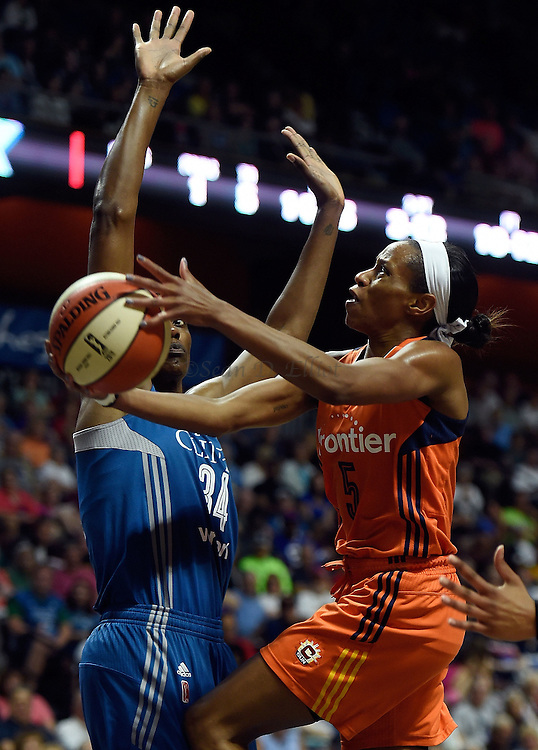 7/7/16 :: SPORTS :: GRIFFEN :: Connecticut's Jasmine Thomas puts up a  shot over Minnesota's Sylvia Fowles in WNBA action Thursday, July 7, 2016 at Mohegan Sun Arena. The Sun came back to take a 93-89 overtime win over the defending WNBA champion Lynx. (Sean D. Elliot/The Day)