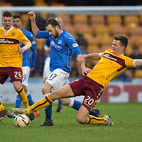 Motherwell v St Johnstone...31.01.15    SPFL<br /> James McFadden is tackled by Fraser Kerr<br /> Picture by Graeme Hart.<br /> Copyright Perthshire Picture Agency<br /> Tel: 01738 623350  Mobile: 07990 594431