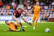 CAPTION CORRECTION Newport County midfielder Robbie Wilmott (7) fouls Northampton Town midfielder Chris Lines (14) during the EFL Sky Bet League 2 match between Northampton Town and Newport County at the PTS Academy Stadium, Northampton, England on 14 September 2019.