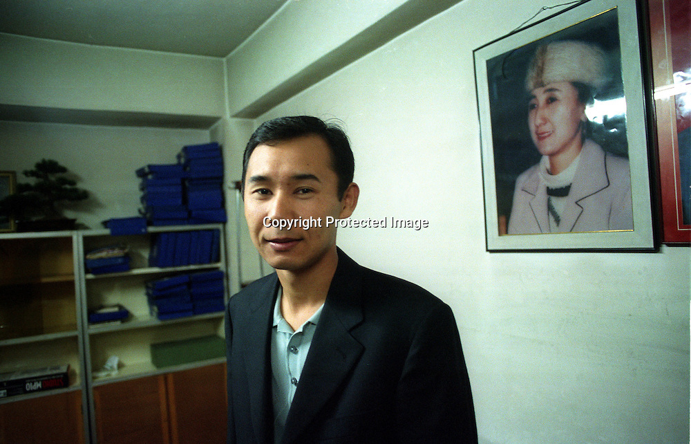 URUMQI , 5 OCOTBER 2001: the son of Rebeya Kadeer in his office in Urumqi.Rebeya Kadeer was a successful businesswoman until she was jailed by Chinese for alledgedly subversive actions ( she had mailed some news clips to her husband in the us ). The Kadeer family is famous in Xinjiang,not only for their business,but also for sponsoring poor students.. Uighur muslims in southern Xinjiang province lead very basic lifestyles and have an average monthly income of about 50USD..(photo by: katharina hesse/Grazia Neri).