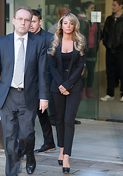 © London News Pictures. 19/12/2013 . TULISA CONTOSTAVLOS leaving Westminster Magistrates court on London where she faced charges of supplying a class A drug. Former X-Factor judge Tulisa and Mike GLC (real name Michael Coombs)  are accused of supplying a class A drug to an investigative journalist. Photo credit : Ben Cawthra/LNP
