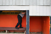 Manchester EMS officer/firefighter paramedic Chris Hickey looks for hidden drug paraphernalia in a dugout at Eric's Field in Manchester, NH Wednesday, Aug. 10, 2016. <br /> To help combat Manchester New Hampshire's huge drug problem, anyone can walk into the main fire station seeking help, they'll get connected with a drug counselor and services. Something like 230 people have shown up in the first couple months and it's quickly spawning copy-cat programs.  <br />    (Cheryl Senter for The Wall Street Journal)