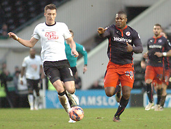 Derby Craig Forsyth battles with Reading Yakubu,  Derby County v Reading, FA Cup 5th Round, The Ipro Stadium, Saturday 14th Febuary 2015