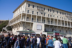 Tourists line up on the dock of Alcatraz Island, Golden Gate National Recreation Area, San Francisco, California.