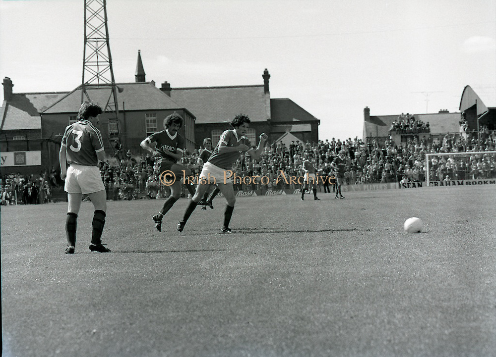 League of Ireland vs Liverpool FC.    (M87)..1979..18.08.1979..08.18.1979..18th August !979..In a pre season friendly the League of Ireland took on Liverpool FC at Dalymount Park Phibsborough,Dublin. The league team was made up of a selection of players from several League of Ireland clubs and was captained by the legendary John Giles. Liverpool won the game by 2 goals to nil..The scorers were Hansen and McDermott...Picture shows Liverpool's Terry McDermott firing in a shot at the Irish goal.