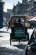 Witney, Oxfordshire, UK. 20th October 2016. Green candidate Larry Sanders, the 83-year-old brother of one-time US presidential hopeful Bernie Sanders canvasses and visits polling stations on the day of the Witney by-election following David Cameron's resignation. Pictured: Larry Sanders takes a ride in a rickshaw to highlight green transport.  // Lee Thomas, Flat 47a Park East Building, Bow Quarter, London, E3 2UT. Tel. 07784142973. Email: leepthomas@gmail.com   www.leept.co.uk (0000635435)