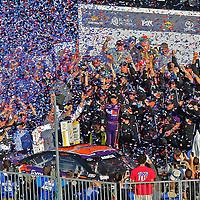 Denny Hamlin (11) celebrates in Gatorade Victory Lane after winning the 58th Annual NASCAR Daytona 500 auto race at Daytona International Speedway on Sunday, February 21, 2016 in Daytona Beach, Florida.  (Alex Menendez via AP)