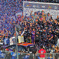 Denny Hamlin (11) celebrates in Gatorade Victory Lane after winning the 58th Annual NASCAR Daytona 500 auto race at Daytona International Speedway on Sunday, February 21, 2016 in Daytona Beach, Florida.  (Alex Menendez via AP)