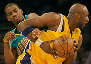 Lakers Lamar Odom gets away from New Orleans Chris Paul who tryed to pick his pocket in the 4th quarter. The Lakers defeated the Hornets 107 to 104 at Staples Center in Los Angeles CA, 4/11/2008. photo by John McCoy/staff photographer LA Daily News.