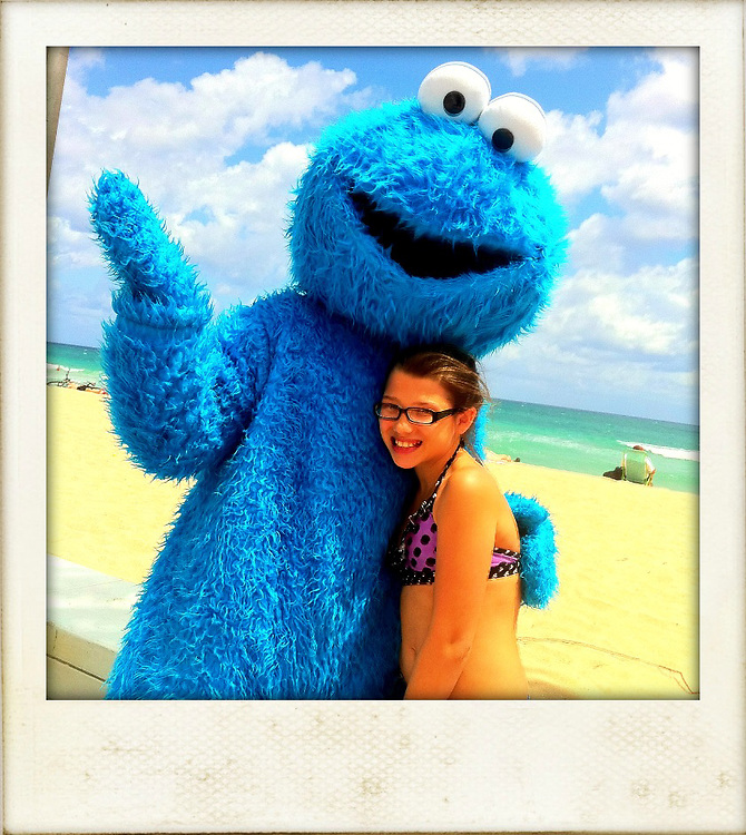 Elmo and young girl on beach,blue skies cellphone photography,Iphone pictures,smartphone pictures