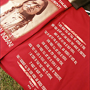 "Old photograph of Chief Sitting Bull on front of tee shirt ""Broken Promises Sure you can trust the Government. Just Ask an Indian"" On back of tee shirt letter for Chief Joseph, Nez Peace. These and other shirt on sale at pow wow"
