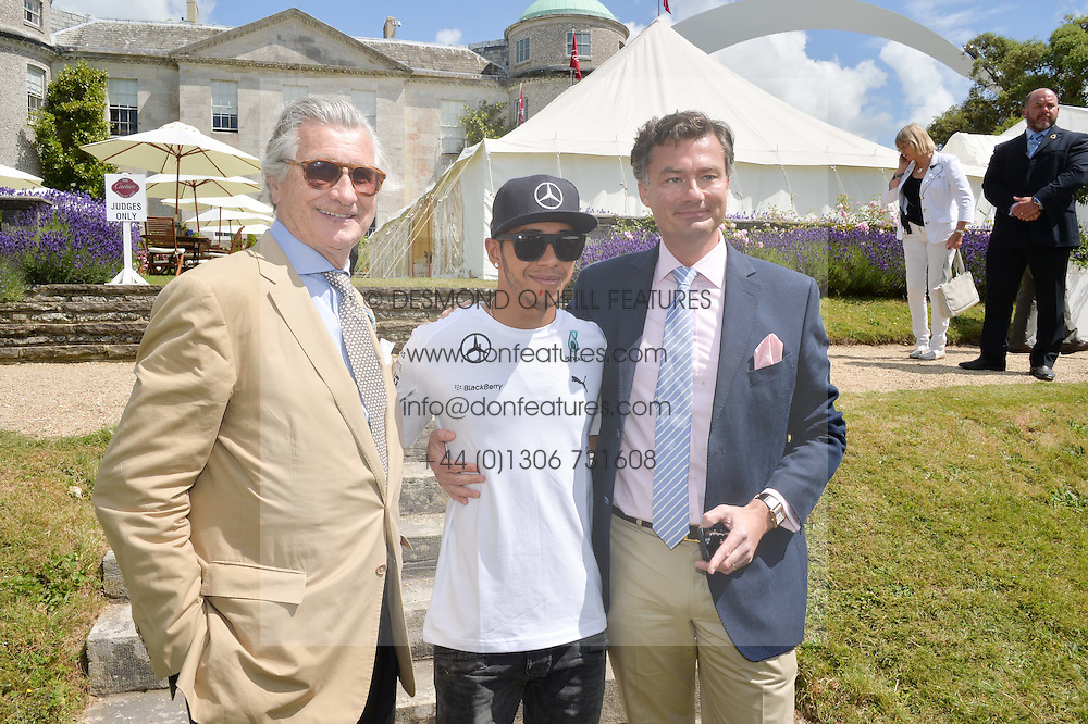 Left to right, ARNAUD BAMBERGER, LEWIS HAMILTON and LAURENT FENIOU MD of Cartier UK at the Cartier hosted Style et Lux at The Goodwood Festival of Speed at Goodwood House, West Sussex on 29th June 2014.