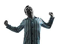 one man in pajamas waking up stretching silhouettes on white background