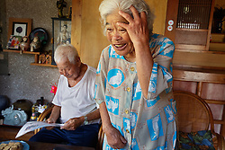 Fumi Tamaki and her husband, 98-year-old farmer Shimpuku Tamaki, enjoy each other's company at their home in Ogimi, Japan.