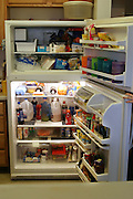 An open refrigerator of a family with 4 children in San Antonio, Texas, USA. (Supporting image from the project Hungry Planet: What the World Eats)