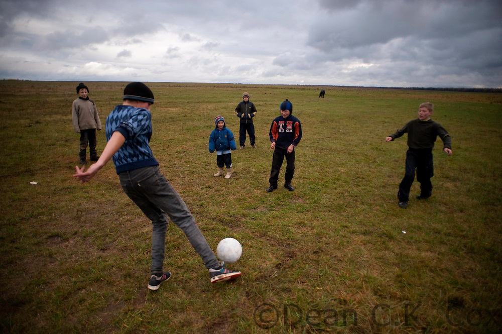Boys play football in a wide open field near the village of Ivanovka on Oct. 28, 2009. Landlocked Belarus is 207,000 square kilometers of generally flat agricultural land and some marshes.