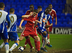 BIRKENHEAD, ENGLAND - Thursday, March 25, 2010: Liverpool's Martin Kelly scores the opening goal against Wigan Athletic during the FA Premiership Reserves League (Northern Division) match at Prenton Park. (Photo by David Rawcliffe/Propaganda)