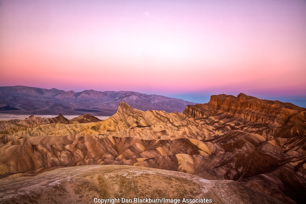 Manly Beacon at Sunrise as seen from Zabriskie Point in Death Valley, California