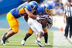 September 24, 2011; San Jose, CA, USA;  New Mexico State Aggies running back Kenny Turner (front) is tackled by San Jose State Spartans defensive back Ronnie Yell (back) and linebacker Derek Muaava (left) during the fourth quarter at Spartan Stadium. San Jose State defeated New Mexico State 34-24.