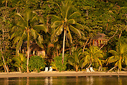 Beach and guest lodging at Matangi Private Island Resort, Fiji.