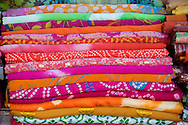 A pile of brightly coloured scarves for sale in the Sardar Market in the old city section of Jodhpur, Rajasthan, India