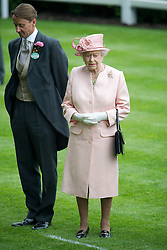 © London News Pictures. 18/06/2013. Ascot, UK.  HRH Queen Elizabeth II during a one minute silence for Sir Henry Cecil, on day one of Royal Ascot at Ascot racecourse in Berkshire, on June 18, 2013.  The 5 day showcase event,  which is one of the highlights of the racing calendar, has been held at the famous Berkshire course since 1711 and tradition is a hallmark of the meeting. Top hats and tails remain compulsory in parts of the course. Photo credit should read: Ben Cawthra/LNP