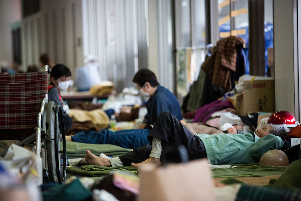 KUMAMOTO, JAPAN - APRIL 21: Earthquake survivors take rest in the morning of April 21, 2016 in Mashiki Gymnasium evacuation center, Kumamoto, Japan. To date 45 people are confirmed dead and around 11,000 people have evacuated after an 6.5 earthquake on Thursday night and a stronger 7.3 quake on Saturday morning struck the Kyushu Island in western Japan.<br /> <br /> Photo: Richard Atrero de Guzman