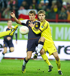 MOSCOW, RUSSIA - Thursday, November 8, 2012: Liverpool's Adam Morgan in action against FC Anji Makhachkala's Arseni Logashov during the UEFA Europa League Group A match at the Lokomotiv Stadium. (Pic by David Rawcliffe/Propaganda)
