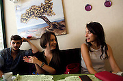 Hasan Cakir, 21 (left)<br /> Pelin Cakiroglu (middle)  17, English-speaking student <br /> and Ayce Sena Akin (right) 18 in Trabzon caf&eacute; <br /> Photography by John Wreford