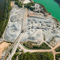 Quarry and tailings pond along the Shenandoah River. Recreational river users appear unaware of the industrial complex beside them.