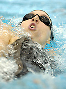 New Zealand's Hannah McLean in action during the 100m backstroke heats at the 2006 Telstra Commonwealth Games Swimming Trials, Melbourne Sports and Aquatics Centre, on Tuesday 31 January, 2006. Photo: Sport the Library/PHOTOSPORT<br /><br /><br />144504