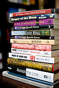 A stack of books by local authors at Purple Crow Books in Hillsborough, NC.