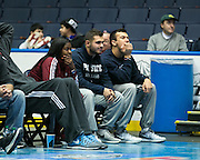 Aquinas Institute quarterback Jake Zembiec, far right, watches as the Razorsharks take on the Carolina Vipers at the Blue Cross Arena on Saturday, December 6, 2014.