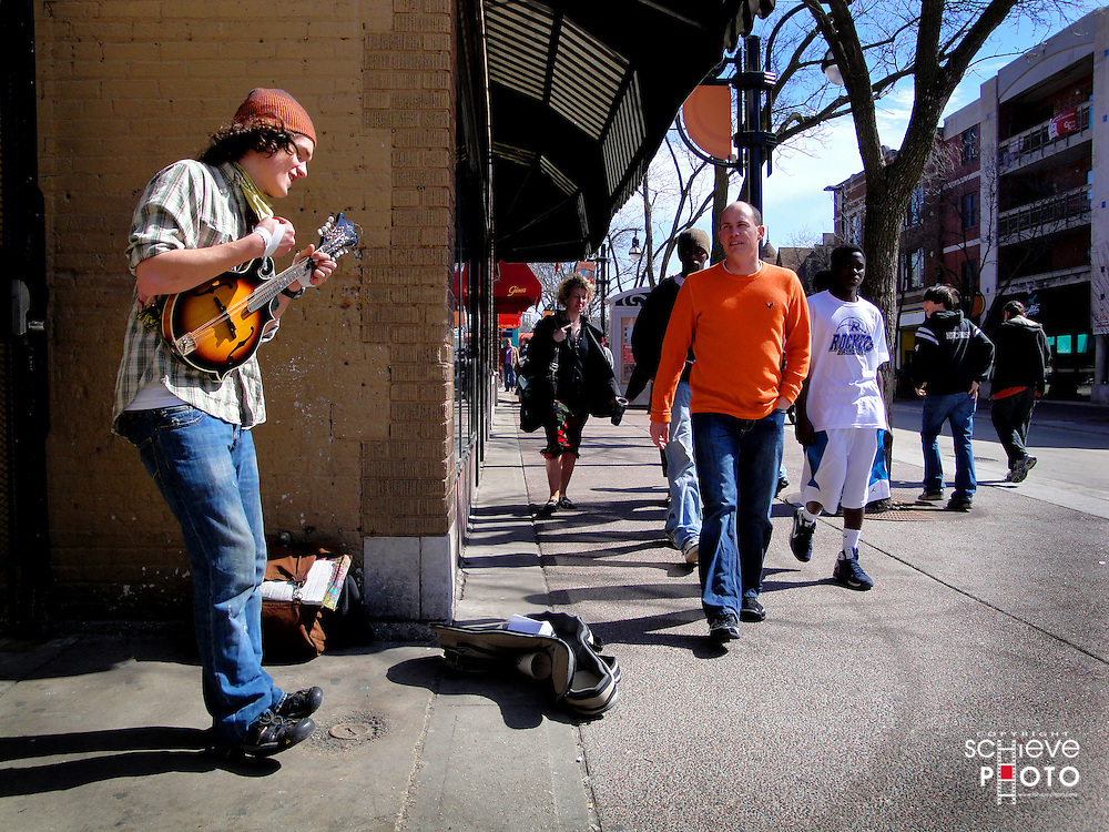 Street musician performs on State Street in Madison, Wisconsin.