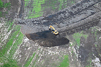 Aerial view of  Land Fill and Catapiller Heavy Equipment moving dirt