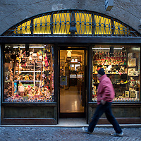 Bergamo, Italy - A man enters in a toy store in Via Gombino, the main street of the historical centre of Città Alta, Upper Bergamo