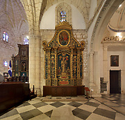 Altarpiece of Nuestra Senora de la Antigua, 17th century, between the choir (left) and the Chapel of Santa Ana or the Bishop of Bastidas (right), in the Catedral Nuestra Senora de la Encarnacion, or the Basilica Cathedral of Santa Maria la Menor, dedicated to St Mary of the Incarnation, built 1514-35 in Renaissance and Gothic style, in the Colonial Zone of Santo Domingo, capital of the Dominican Republic, in the Caribbean. The building is also known as the Catedral Primada de America as it is the oldest cathedral in the Americas. Santo Domingo's Colonial Zone is listed as a UNESCO World Heritage Site. Picture by Manuel Cohen