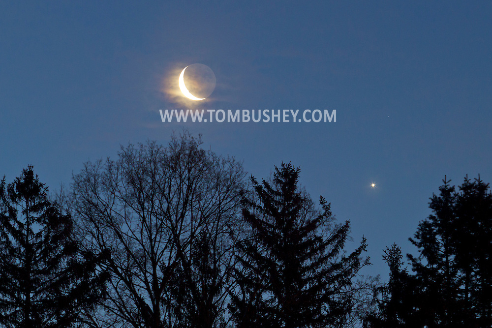 Middletown, New York - The crescent moon and Venus shine in the eastern sky before dawn  on  March 27, 2014.