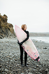 LAHINCH, IRELAND. MARCH 22, 2018;  Surfer Sophie Hellyer is seen in her wetsuit after an early morning surf on March 22, 2018 in Lahinch, Ireland. Sophie, a former English champion regularly surfs in the Atlantic in a full wetsuit. She is a keen environmentalist and highlights the need for more diversity in female role models to make surfing culture a more healthy and empowering place for women (and men) of all ages. For more information here https://www.sophiehellyer.com/blogposts/2018/3/23/media-wars (Credit Tom Shaw)