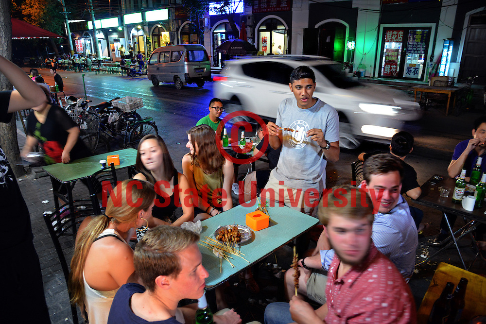 Poole College of Management Study Abroad students enjoy late night street food after a day of touring Beijing and singing karaoke.