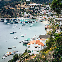 Catalina Island Avalon Bay from above picture. Photo includes the Green Pleasure Pier and Avalon city waterfront businesses. Catalina Island is a popular travel destination off the coast of Southern California in the United States.