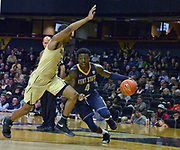 Kent State Golden Flashes guard Antonio Williams (4) drives against Vanderbilt Commodores guard Joe Toye (2) during the second half of an NCAA basketball game in Nashville, Tenn., Friday, Nov. 23, 2018. Kent State won 77-75. (Jim Brown/Image of Sport)