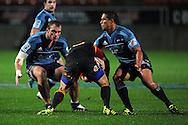 Mike Delaney gets tackled by Luke Braid and Kurtis Haiu. Investec Super Rugby - Chiefs v Blues, Waikato Stadium, Hamilton, New Zealand. Saturday 26 March 2011. Photo: Andrew Cornaga / photosport.co.nz