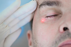 Man Receiving Laser Treatment on Face