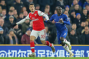 Arsenal forward Gabriel Martinelli (35) battles with Chelsea midfielder Ngolo Kanté (7), during the Premier League match between Chelsea and Arsenal at Stamford Bridge, London, England on 21 January 2020.