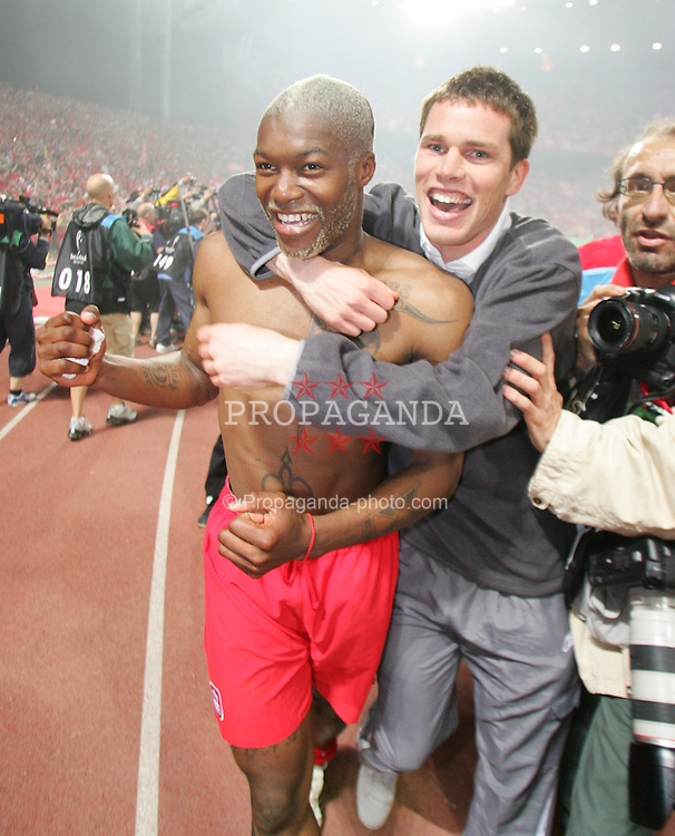 ISTANBUL, TURKEY - WEDNESDAY, MAY 25th, 2005: Liverpool's Djibril Cisse celebrates with Steve Finnan after beating AC Milan on penalties during the UEFA Champions League Final at the Ataturk Olympic Stadium, Istanbul. (Pic by David Rawcliffe/Propaganda)